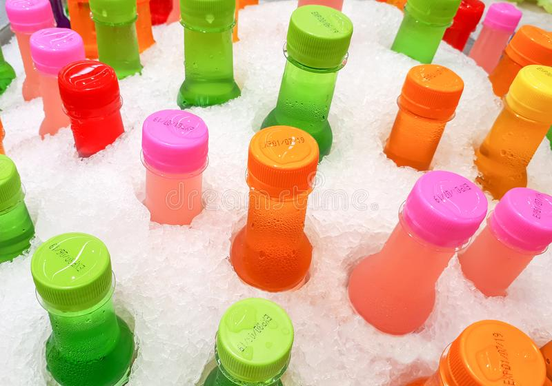 Colorful bottles of cool soft drinks stock image