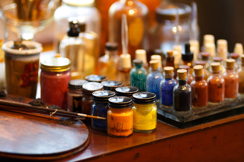Colorful bottles of paint royalty free stock photos