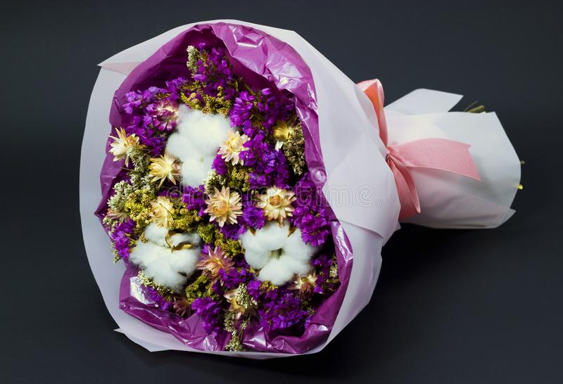 Colorful bouquet of dry wildflowers and cotton stock photography