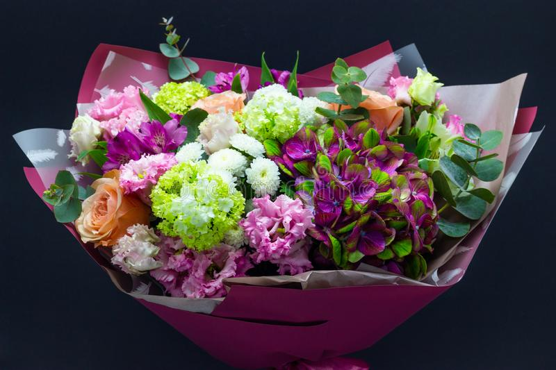 Colorful bouquet of flowers on a dark background stock photos