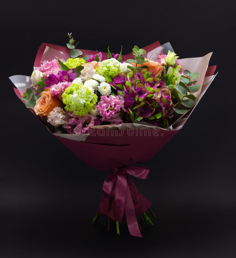 Colorful bouquet of flowers on a dark background royalty free stock image