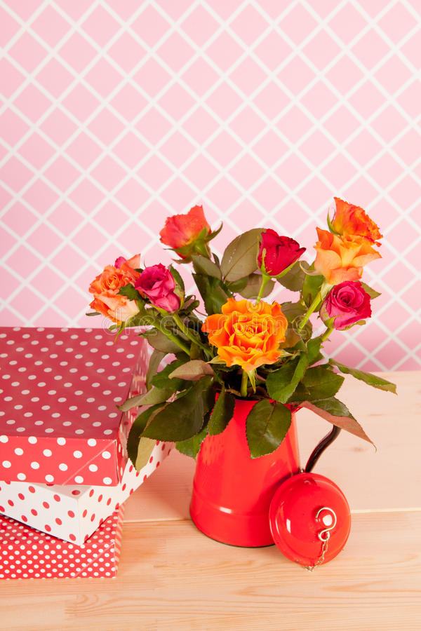 Colorful bouquet roses and presents stock images