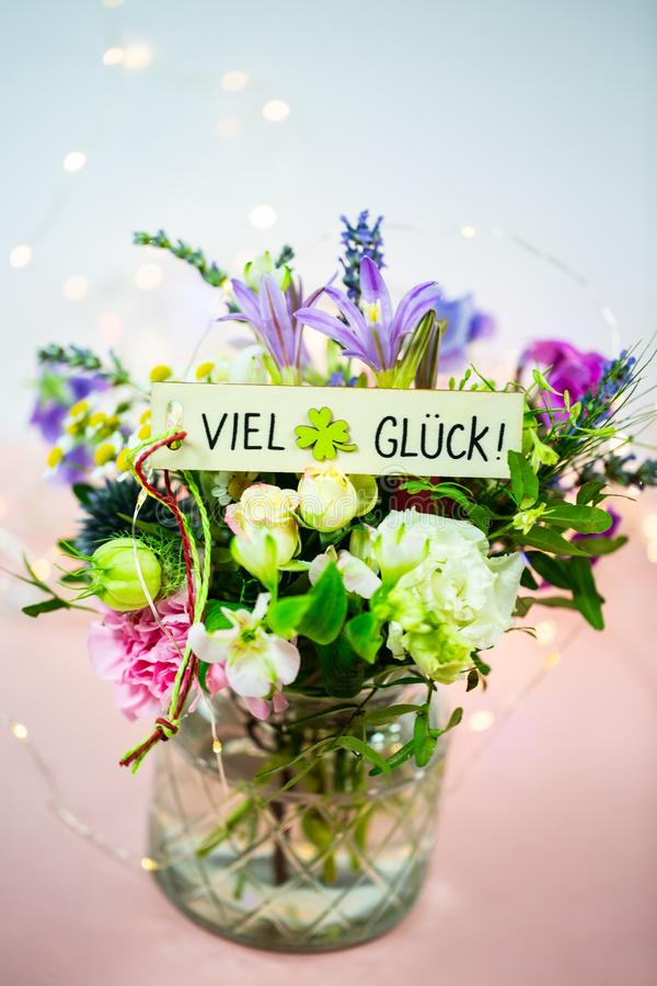 Colorful bouquet, with signboard, good luck, pink background, white background stock images