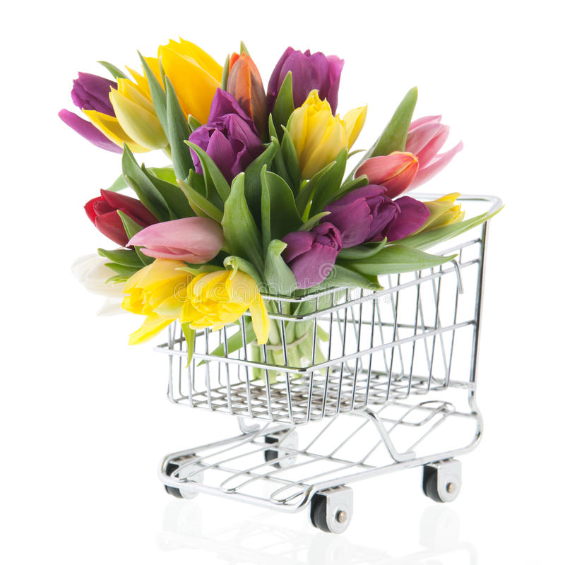 Colorful bouquet tulips in shopping cart