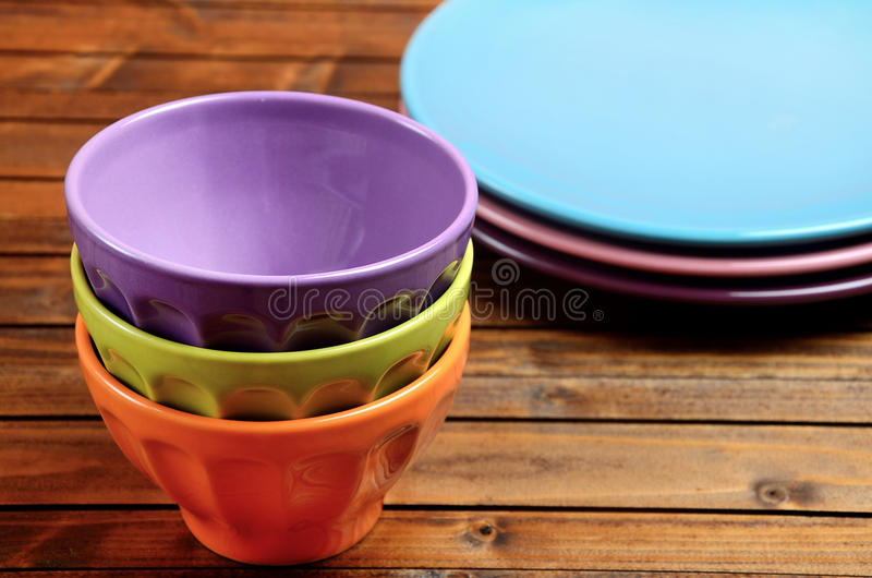 Colorful bowl with plate on table. Colorful bowl with plate on wooden table stock images