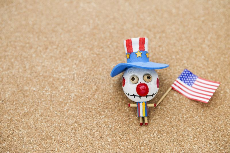 Colorful bozo wooden ghost with American flag royalty free stock images