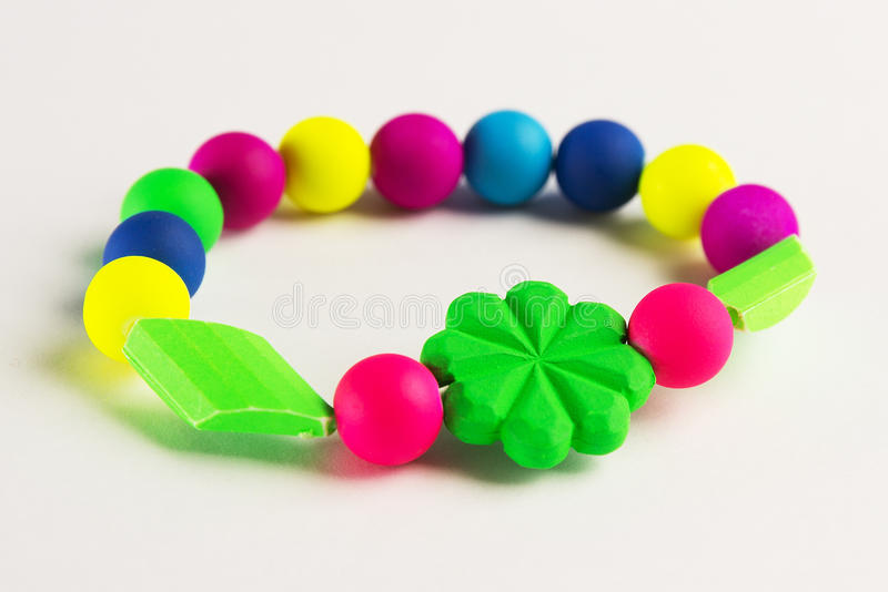 Colorful bracelet for kids. On the white background stock images