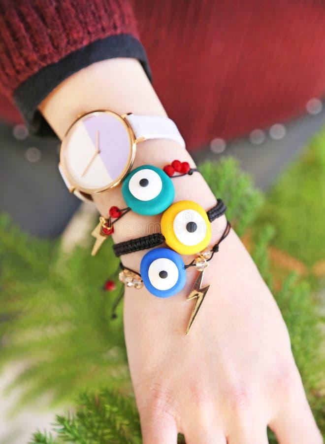 Colorful bracelets advertisement with greek evil eye royalty free stock photo