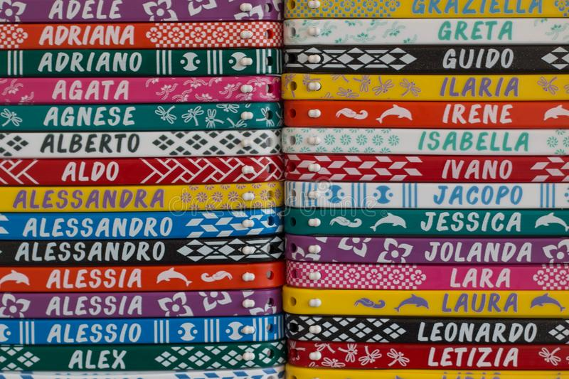 Colorful bracelets with names, a typical italian souvenir. stock photos