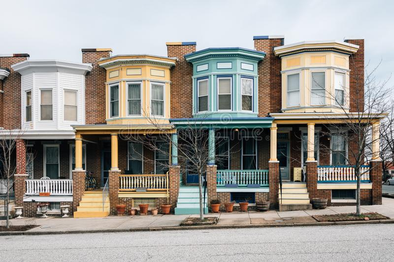 Colorful brick row houses in Charles Village, Baltimore, Maryland.  stock photo