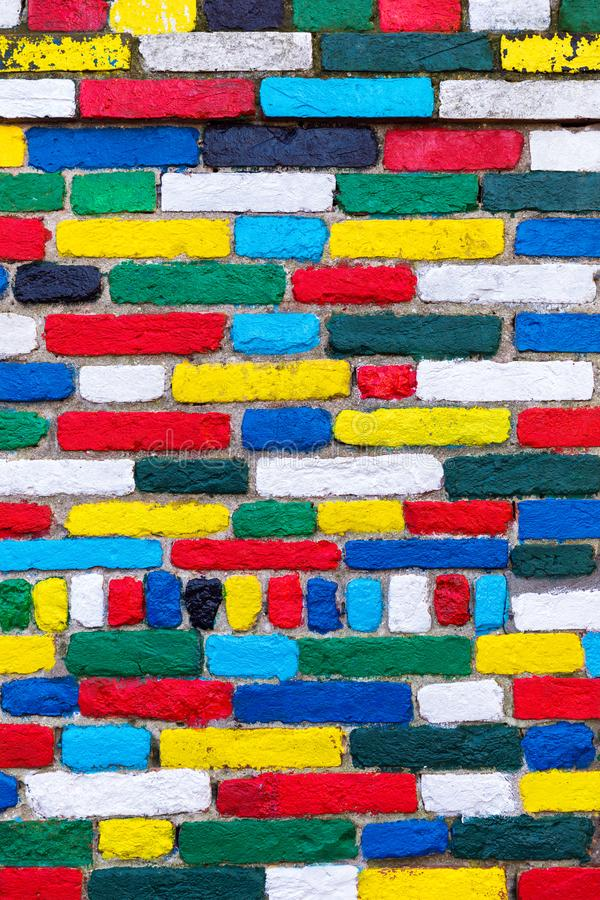 Colorful brick wall background. Rainbow colourful brick wall. Co royalty free stock photo
