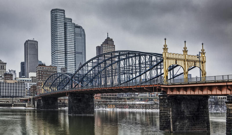 Colorful bridge with Pittsburgh skyline stock photography