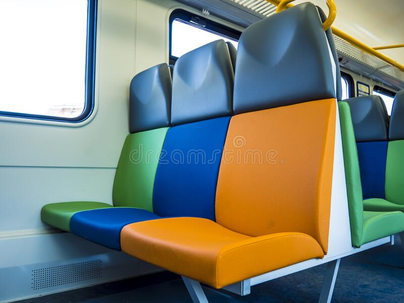 Colorful bright colors new seats in an empty suburban train. royalty free stock photos