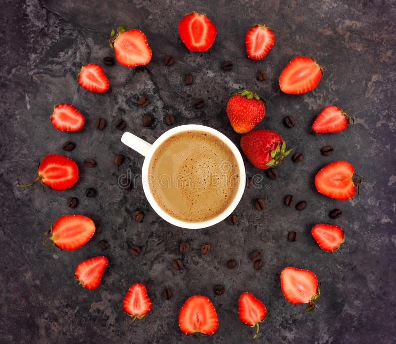 Colorful bright composition of cup of coffee and strawberries flower royalty free stock images