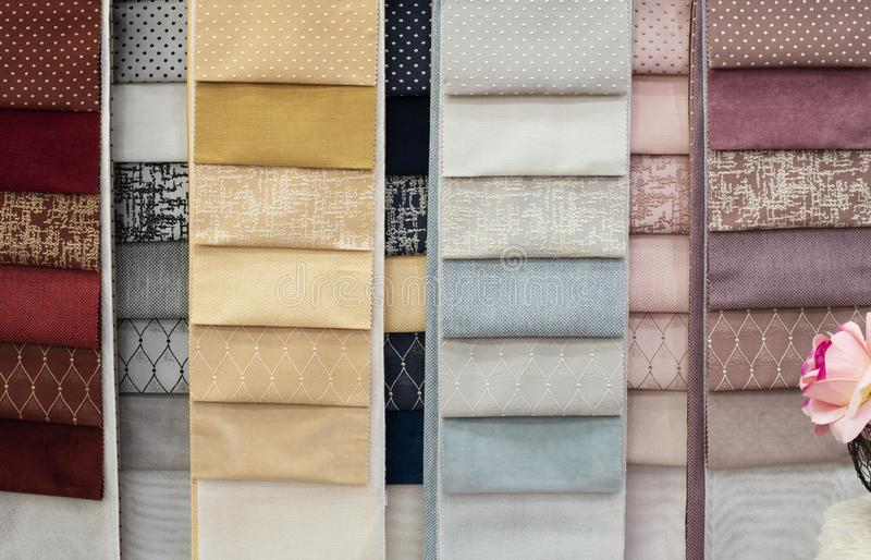 Colorful and bright curtains fabric pattern palette texture samples as abstract textile background. Handmade, clothes and. Furniture decoration concept. Scraps stock photography