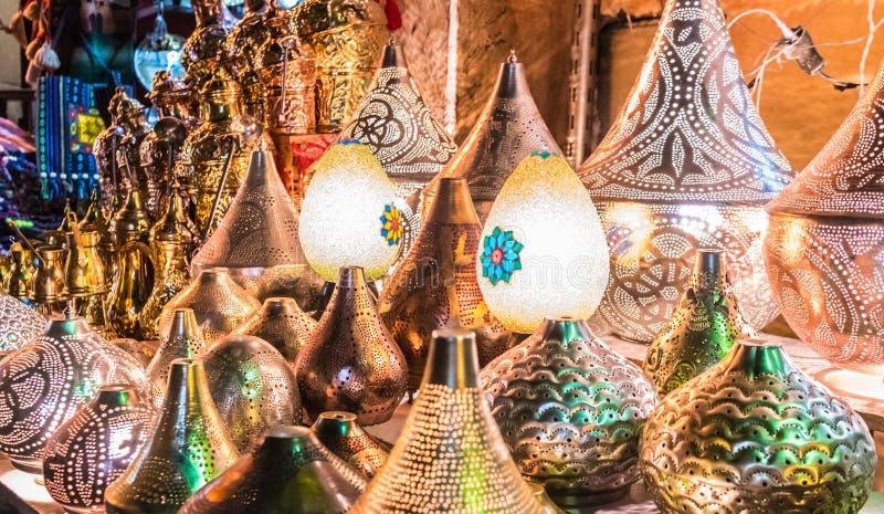 Lamps on display in Al Moez street. Colorful, bright, Egg shaped and metallic lamps on display in Khan Al Khalili bazaars in Al Moez street royalty free stock photos