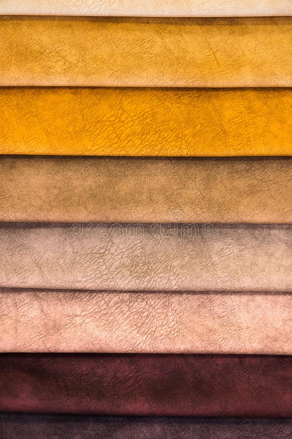 Colorful and bright fabric samples of furniture and clothing upholstery. Close-up of a palette of textile abstract royalty free stock image