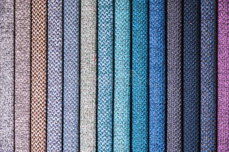 Colorful and bright fabric samples of furniture and clothing upholstery. Close-up of a palette of textile abstract. Stripes of different colors royalty free stock image