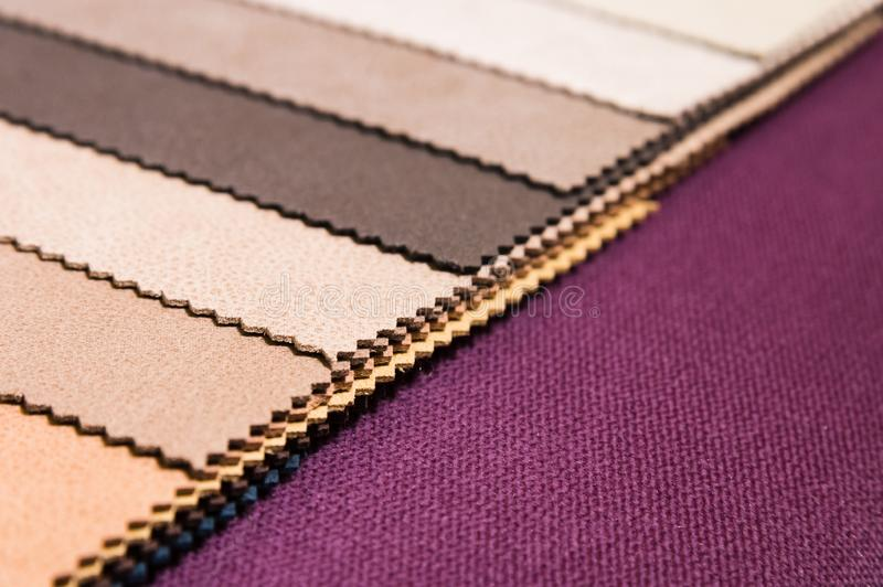 Colorful and bright fabric samples of furniture and clothing upholstery. Close-up of a palette of textile abstract. Stripes of different colors stock images