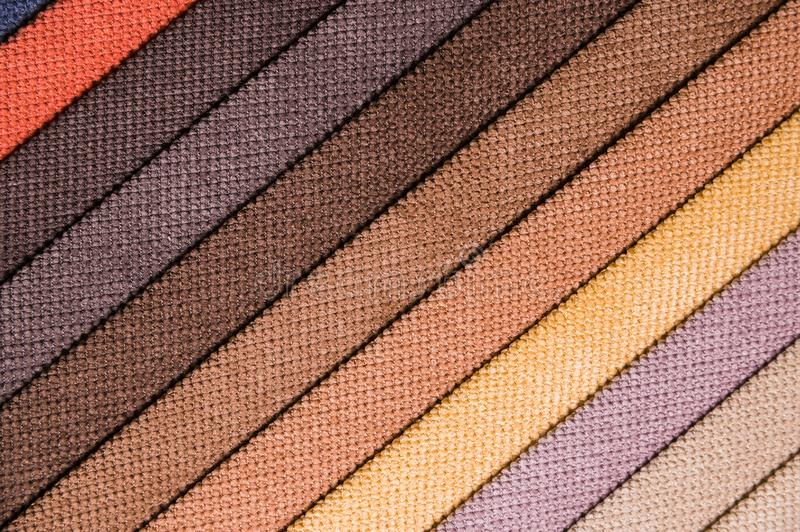 Colorful and bright fabric samples of furniture and clothing upholstery. Close-up of a palette of textile abstract. Stripes of different colors royalty free stock photos