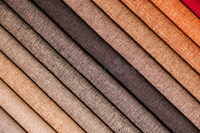 Colorful and bright fabric samples of furniture and clothing upholstery. Close-up of a palette of textile abstract. Stripes of different colors royalty free stock images