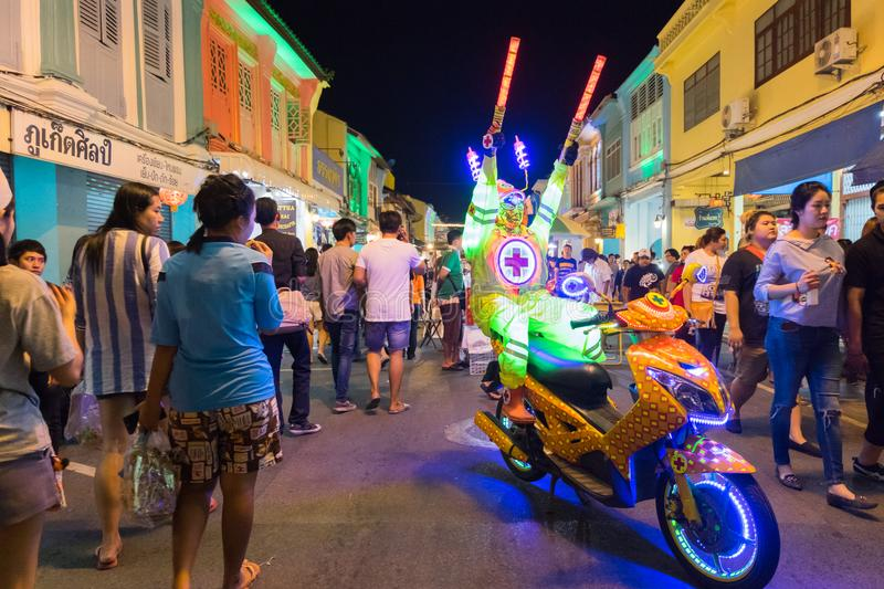 Colorful bright model on motorcycle in18th Phuket chinese new ye royalty free stock photo