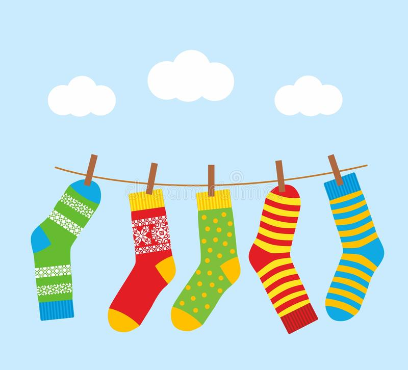 Colorful bright socks on a rope with clothespins against a background of sky and clouds. stock illustration