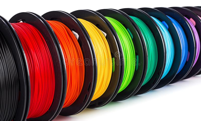 Colorful bright wide panorama row of spool 3d printer filament royalty free stock photo