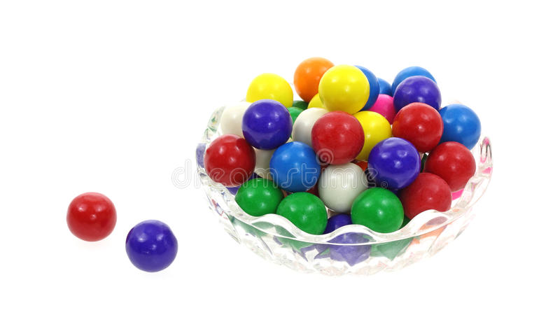 Colorful Bubble Gum Balls. A bowl of colorful bubble gum balls plus two singles royalty free stock photos