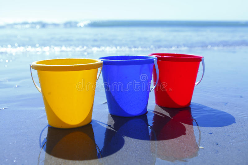 Download Colorful buckets on beach stock photo. Image of blue - 25160408