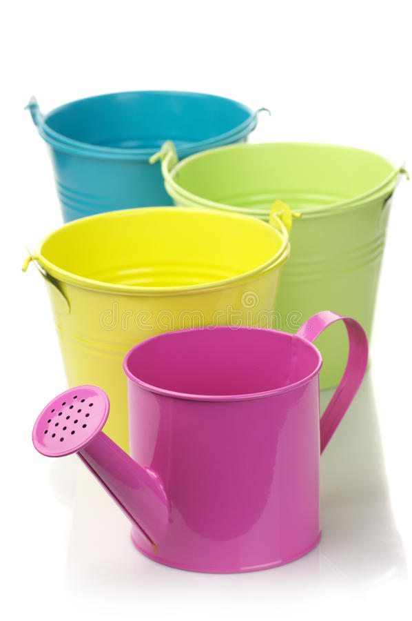 Colorful Buckets And Watering Can Royalty Free Stock Images