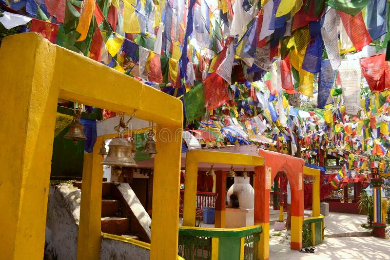Colorful buddhism prayer flags in Mahakal temple stock photography