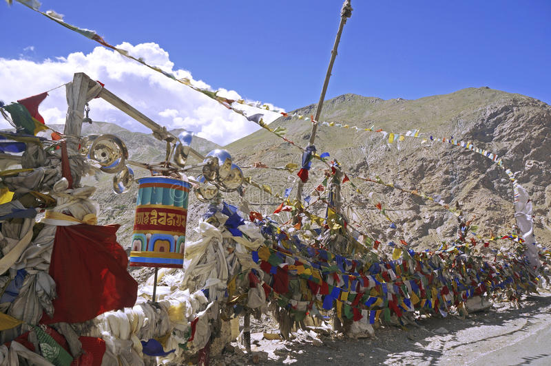 Colorful Buddhist Prayer Flags on a Mountain Pass in the Himalayas royalty free stock photography