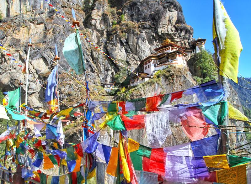 Colorful Buddhist prayer flags at Taktshang Goemba. Or Tiger`s nest monastery in Paro, Bhutan stock photos