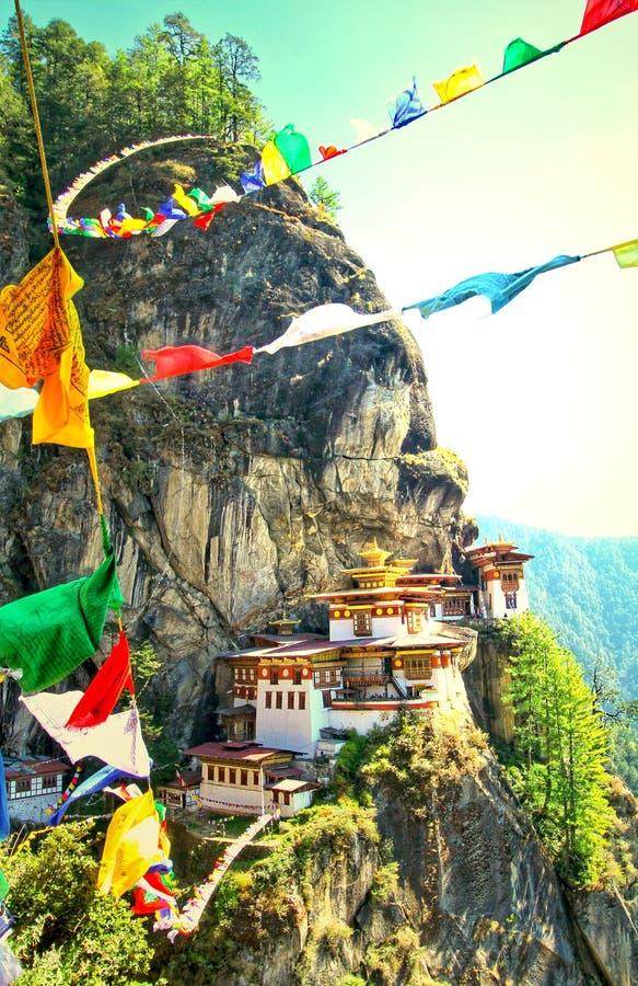 Colorful Buddhist prayer flags at Taktshang Goemba or Tiger`s ne. St monastery in Paro, Bhutan royalty free stock photo