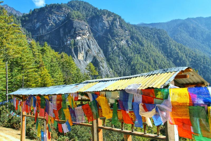 Colorful Buddhist prayer flags at Taktshang Goemba or Tiger`s ne. St monastery in Paro, Bhutan stock image