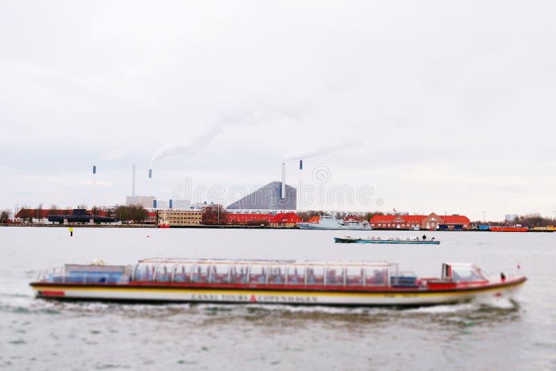 Colorful building and boats in river in copenhagen danmark. Copenhagen danmark scenery stock photos