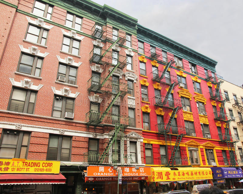 Colorful building in chinatown. Colorful apartment building painted in red,green and yellow in chinatown,nyc stock photos