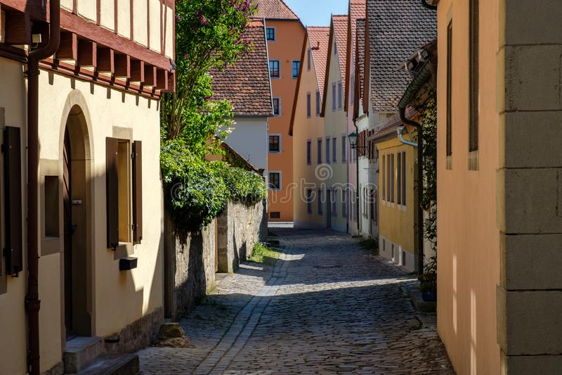 Colorful building in old street of Rothenburg ob der Tauber, Bavaria, Germany. stock photo