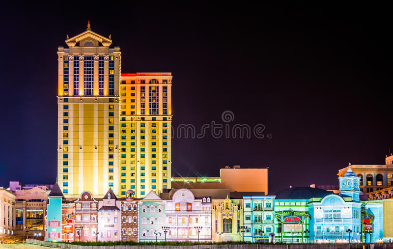 Colorful buildings along the boardwalk at night in Atlantic City stock photo