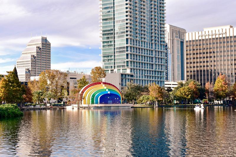 Colorful buildings and autumn forest at Lake Eola Park on beautiful sunset background in Orlando Downtown area 3 royalty free stock photography