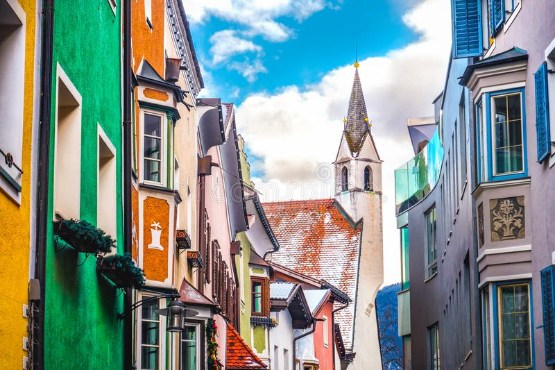 Colorful buildings church village of Vipiteno Sterzing - Bol. Zano Bozen - Trentino Alto Adige South Tyrol region Italy stock photos