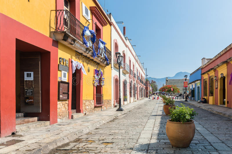 Colorful buildings on the cobblestone streets of Oaxaca, Mexico. Oaxaca, Mexico - April 17, 2017: Colorful buildings on the cobblestone streets of Oaxaca, Mexico stock photo