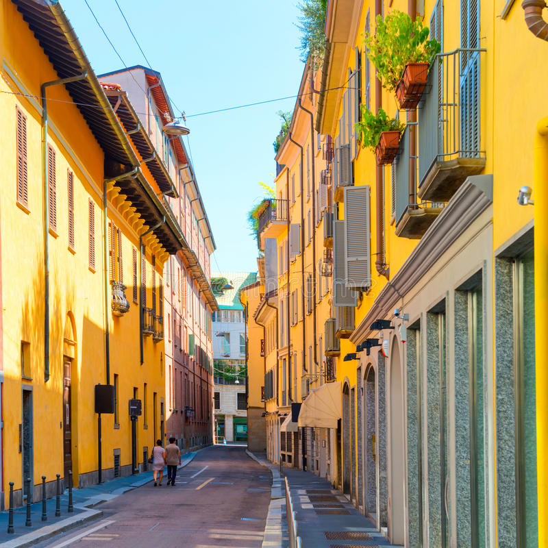 Colorful buildings and couple on the street. Colorful buildings and love couple on the old european street in the city of Milan, Italy royalty free stock photos