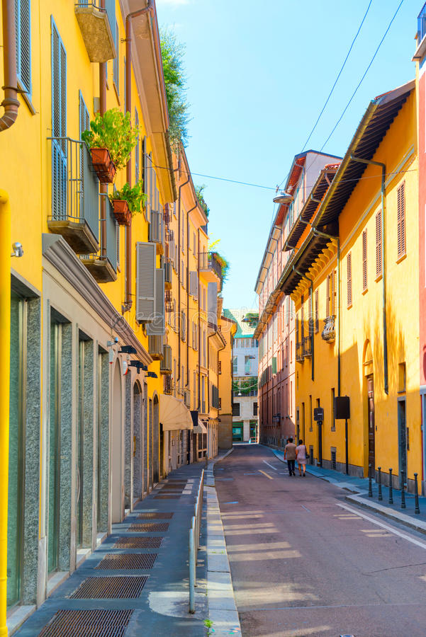 Colorful buildings and couple on the street. Colorful buildings and love couple on the old european street in the city of Milan, Italy royalty free stock photography
