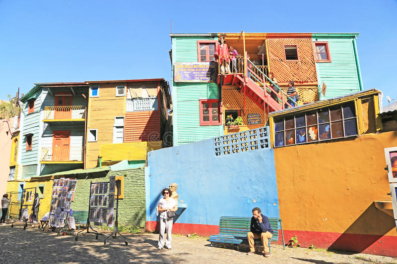 Colorful buildings, La Boca in Buenos Aires. Buenos Aires, Argentina ? March, 23 2014 : Tourists admiring colorful building and street art in the famous district stock photography