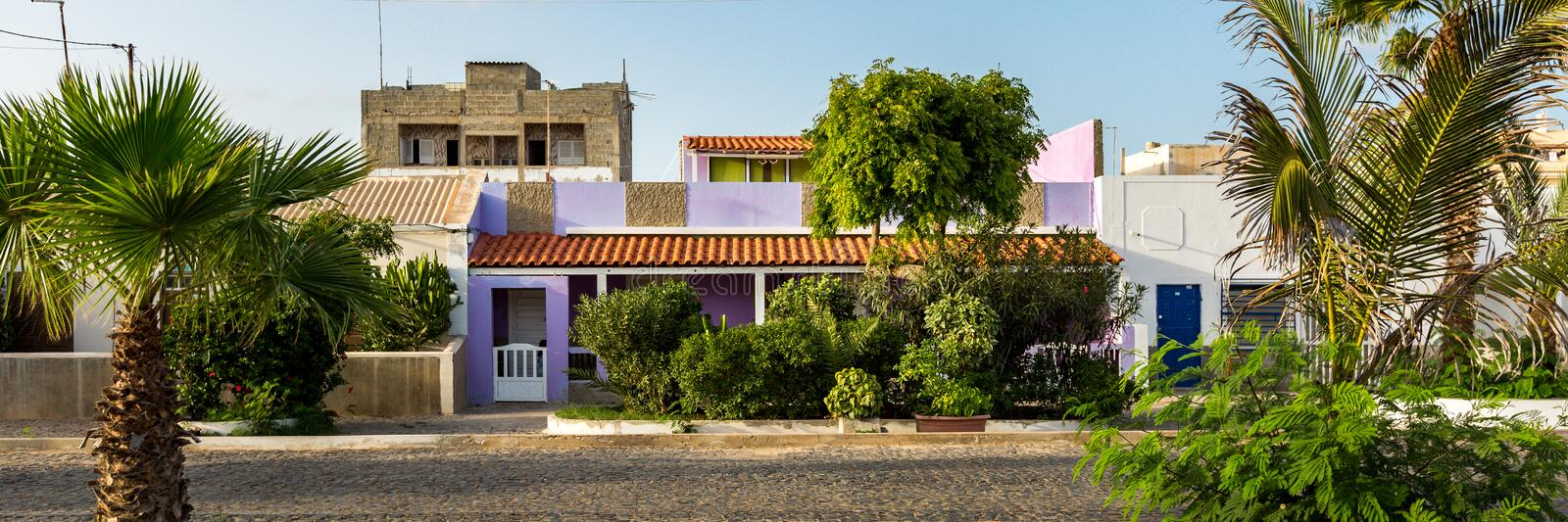 Colorful buildings and palm trees. Panorama of colorful buildings and palm trees in city of Santa Maria, Sal island, Cabo Verde, Cape Verde royalty free stock photo