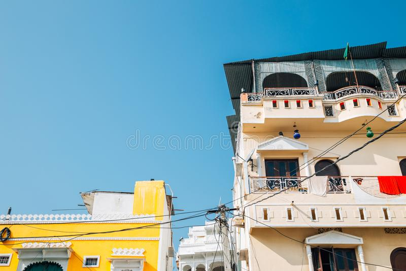 Colorful buildings in Udaipur, India. Colorful buildings under blue sky in Udaipur, India royalty free stock photos