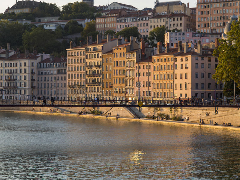 Colorful buildings washed with sun on the Rhone river bank at Ly stock images