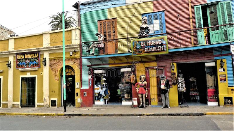 Buenos Aires La Boca neighborhood. Colorful bulding and statues in La Boca using colors the surplus paints of the port royalty free stock images